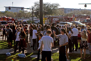 Students are released from a lockdown outside of Stoneman Douglas High School in Parkland, Fla. after reports of an active shooter on Wednesday, Feb. 14, 2018.