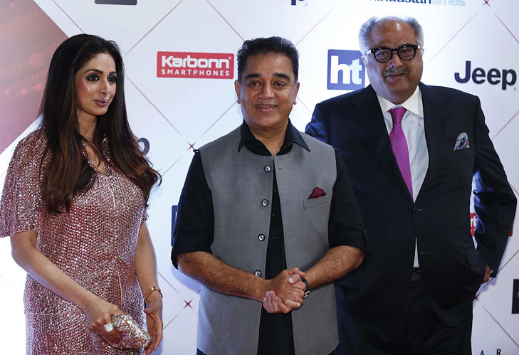 Indian Bollywood actors Sridevi (L), Kamal Haasan (C) and producer Boney Kapoor (R) pose for a picture.