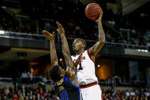 Tulsa's Junior Etou, left, defends as Cincinnati's Gary Clark, right, takes a shot during the second half of an NCAA college basketball game, Sunday, Feb. 25, 2018, in Highland Heights, Ky. Cincinnati won 82-74. (AP Photo/Aaron Doster)