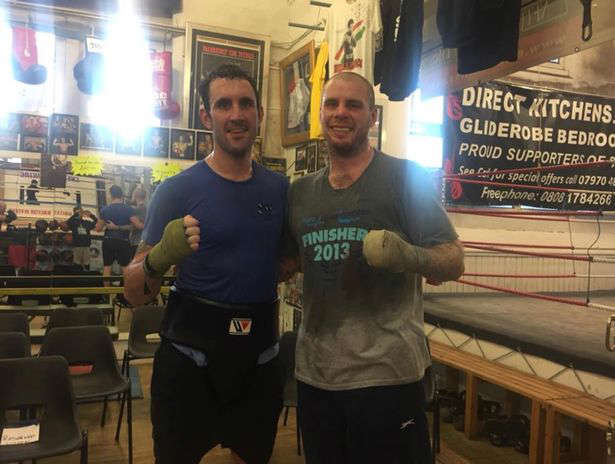 Westgarth (left) in the gym