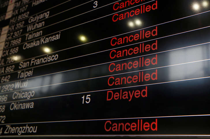 A panel displaying cancelled and delayed flights