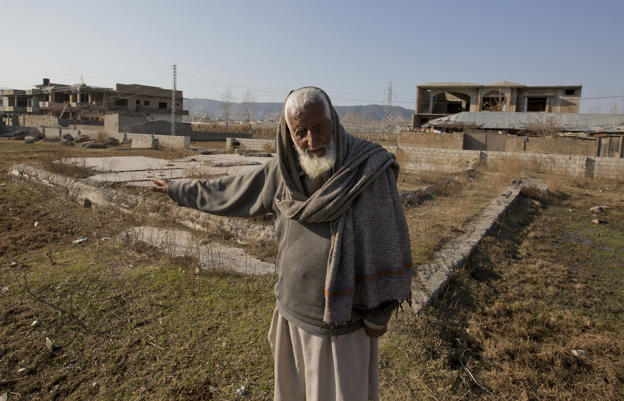 In this Jan. 7, 2018 photo, Zain Muhammad, a former watchman for Osama bin Laden talks about him at the remains of bin Laden's house, in Abbottabad, Pakistan.