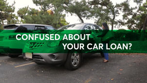 a green truck parked in a parking lot: 5 Car Loan Misconceptions
