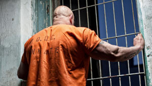 a man standing in front of a fence: As of 2010, the U.S. spent $80 billion on corrections expenditures at the federal, state and local levels, according to The Brookings Institute, the most recent and widely reported figure. Of that amount, $38.8 billion has fallen onto the taxpayers, according to a 2012 Vera Institute of Justice report. However, some states spend more on corrections and expenses than others, due to a variety of factors.Click through to find out how much prison inmates are costing the 20 top-spending states.
