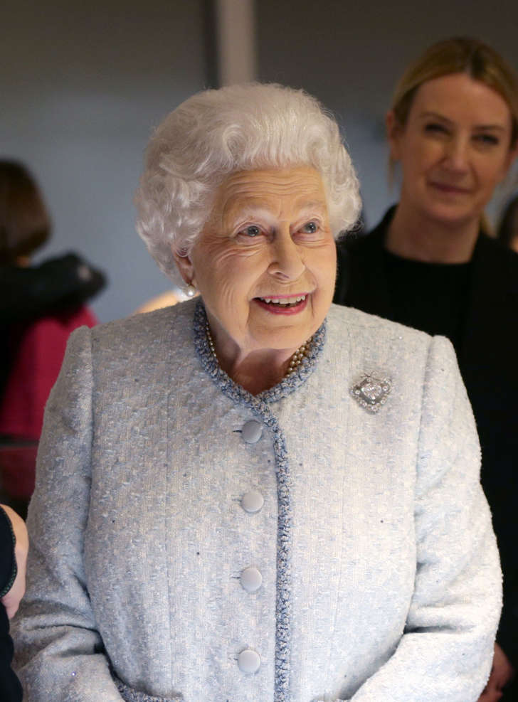 Queen Elizabeth II reacts as she visits London Fashion Week's BFC Show Space in central London.