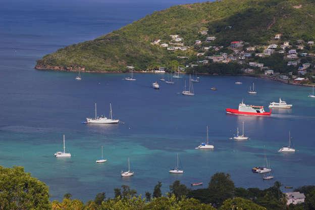 Διαφάνεια 25 από 51: A view of the passenger ferry leaving Admiralty Bay, in Bequia.  Part of St. Vincent and the Grenadines.