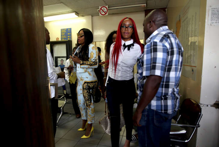 Media personality Uyanda Mbuli and socialite Joyce Molamu inside the Midrand Magistrate's Court on February 28, 2018 in Midrand, South Africa. Molamu was found guilty of defaming Mbuli in a Facebook post. The case was postponed to March 14 for mitigation.