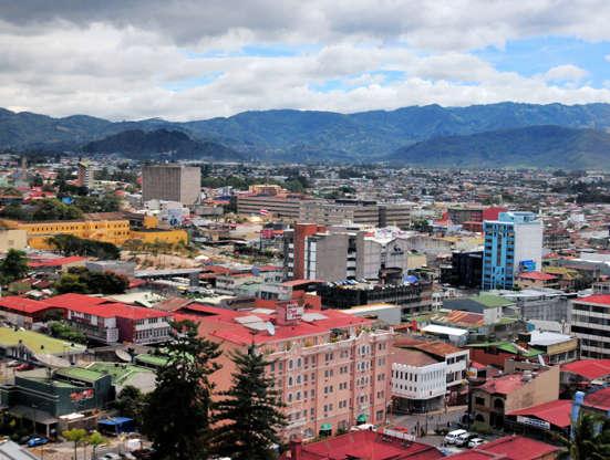 Διαφάνεια 22 από 51: San José, Costa Rica: city center skyline with mountans in the background - several different logos/brands on the respective buildings - photo by M.Torres