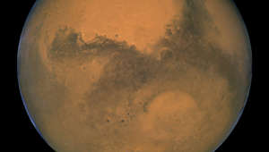 NASA's Hubble Space Telescope took this close-up of Mars when it was just 34,648,840 miles (55,760,220 km) away. The picture was taken just 11 hours before the planet made its closest approach to Earth in 60,000 years. Many small, dark, circular impact craters can be seen, attesting to the Hubble telescope's ability to reveal fine detail on the planet's surface. One of the most striking is the 270-mile- (450-km-) diameter Huygens crater, seen near the centerof the image.