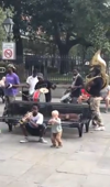 Watch this adorable toddler jam with a New Orleans brass band