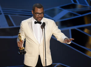 "Jordan Peele accepts the award for best original screenplay for ""Get Out"" at the Oscars on Sunday, March 4, 2018, at the Dolby Theatre in Los Angeles. (Photo by Chris Pizzello/Invision/AP)"