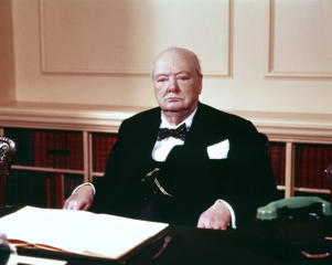 Sir Winston Churchill in the cabinet room at 10 Downing Street.