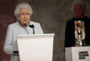 CAPTION: Britain's Queen Elizabeth II speaks before presenting Richard Quinn with the inaugural Queen Elizabeth II Award for British Design as she visits London Fashion Week, in London, Britain February 20, 2018. REUTERS/Yui Mok/Pool
