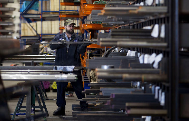 """<span style=""""font-size:13px;"""">Laborers fill orders of machine grade steel to be shipped throughout the Pacific Northwest at the Pacific Machinery & Tool Steel Company on March 6, 2018 in Portland, Oregon.</span>"""