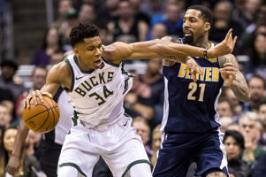 The Bucks forward Giannis Antetokounmpo (34) works for a shot as the Nuggets forward Wilson Chandler (21) defends on Feb. 15, in Milwaukee, WI. The Nuggets won 134-123.