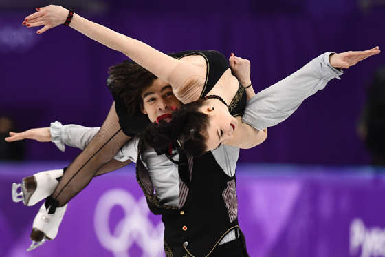 Slide 1 of 110: Slovakia's Lucie Mysliveckova and Slovakia's Lukas Csolley compete in the ice dance free dance of the figure skating event during the Pyeongchang 2018 Winter Olympic Games at the Gangneung Ice Arena in Gangneung on February 20, 2018.