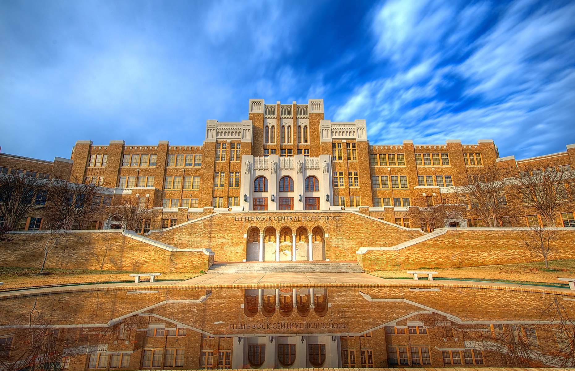 """Slide 5 of 51: Take a guided one-hour tour of this high school that once stood at the center of the U.S. civil rights movement and desegregation. The """"Little Rock Nine"""" were African-American students bussed into the all-white high school, escorted by federal troops, attending classes despite the furor of hatred, ridicule and intimidation directed at them."""