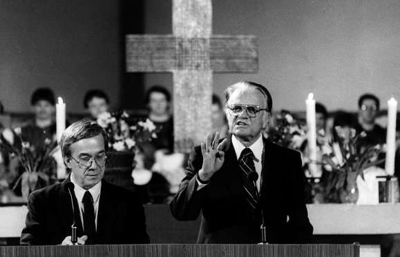 Slide 6 of 9: Graham, Billy 1918-evangelist, baptist (southern convention) preacher, USA delivers a sermon at Berlin (East-Berlin) Gethsemane-church ábout 10.03.1990