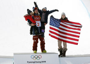 Freestyle Skiing - Pyeongchang 2018 Winter Olympics - Men's Ski Halfpipe Finals - Phoenix Snow Park - Pyeongchang, South Korea - February 22, 2018 - Gold medallist David Wise of the U.S. celebrates with his wife Alexandra and their children Nayeli and Malachi. REUTERS/Issei Kato