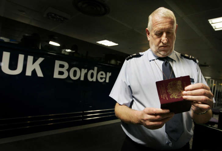 Passports are checked at passport control during the official launch of the UK Border Agency