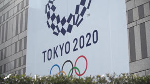 a sign on the side of a building: Toyko is getting ready for the 2020 Summer Olympics
