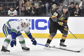 LAS VEGAS, NV - FEBRUARY 23: Troy Stecher #51 of the Vancouver Canucks defends Nate Schmidt #88 of the Vegas Golden Knights during the game at T-Mobile Arena on February 23, 2018 in Las Vegas, Nevada. (Photo by David Becker/NHLI via Getty Images)