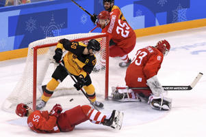 Vasili Koshechkin (83) of Olympic Athlete from Russia allows a goal against Felix Schutz (55) of Germany (not pictured) during the Men's Gold Medal Game on Feb. 25, in Gangneung.