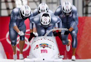 Bobsleigh - Pyeongchang 2018 Winter Olympics - Men's 4-man Competition - Olympic Sliding Centre - Pyeongchang, South Korea - February 24, 2018 - Oskars Melbardis, Daumants Dreiskens, Arvis Vilkaste and Janis Strenga of Latvia start.