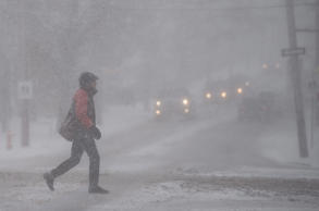 A pedestrian walks through a snow storm in Halifax on Thursday, March 8, 2018. A winter storm brought gusting winds and snow across most of Atlantic Canada.