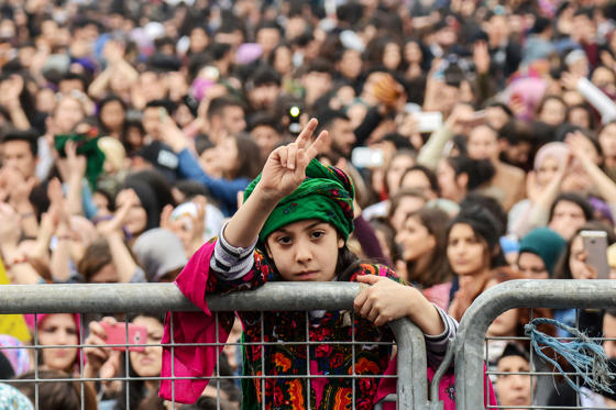 Slide 1 of 23: A girl flashes a victory sign on March 8, 2018 during a demonstration to mark International Women's Day in Diyarbakir, southwestern Turkey. / AFP PHOTO / ILYAS AKENGIN        (Photo credit should read ILYAS AKENGIN/AFP/Getty Images)