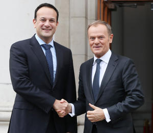 EU Council president Donald Tusk (right) arrives for talks with Taoiseach Leo Varadkar at Government Buildings in Dublin