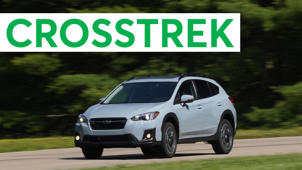 a car parked in front of a sign: 2018 Subaru Crosstrek Road Test