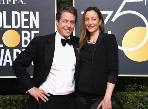 Slide 1 of 31: CAPTION: BEVERLY HILLS, CA - JANUARY 07: 75th ANNUAL GOLDEN GLOBE AWARDS -- Pictured: Actor Hugh Grant (L) and producer Anna Eberstein arrive to the 75th Annual Golden Globe Awards held at the Beverly Hilton Hotel on January 7, 2018. (Photo by Kevork Djansezian/NBC/NBCU Photo Bank via Getty Images)