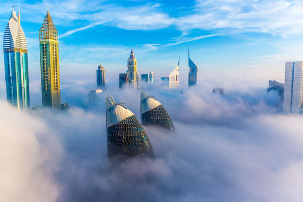 Dramatic Photos Of Dubais Skyscrapers Above The Mist And Clouds