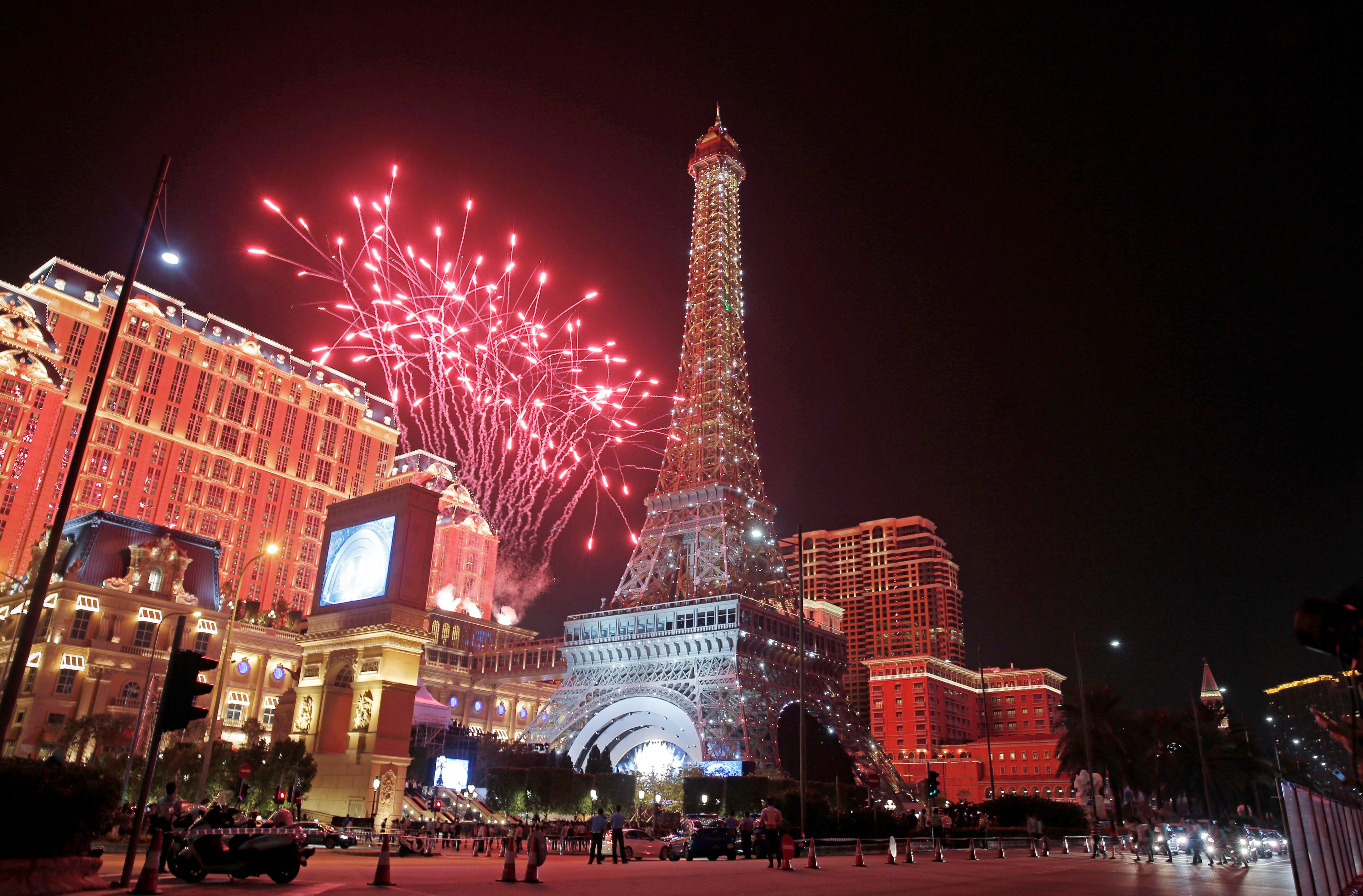 Slide 39 of 57: CAPTION: Fireworks explodes at a replica of the Eiffel Tower of Parisian Macao during an opening ceremony in Macau, China, Tuesday, Sept. 13, 2016. The southern Chinese casino gambling powerhouse of Macau is getting a French twist. U.S. billionaire Sheldon Adelson is set to throw open the doors Tuesday to the French-themed Parisian Macao, the mogul's fifth property in the former Portuguese colony. (AP Photo/Kin Cheung)