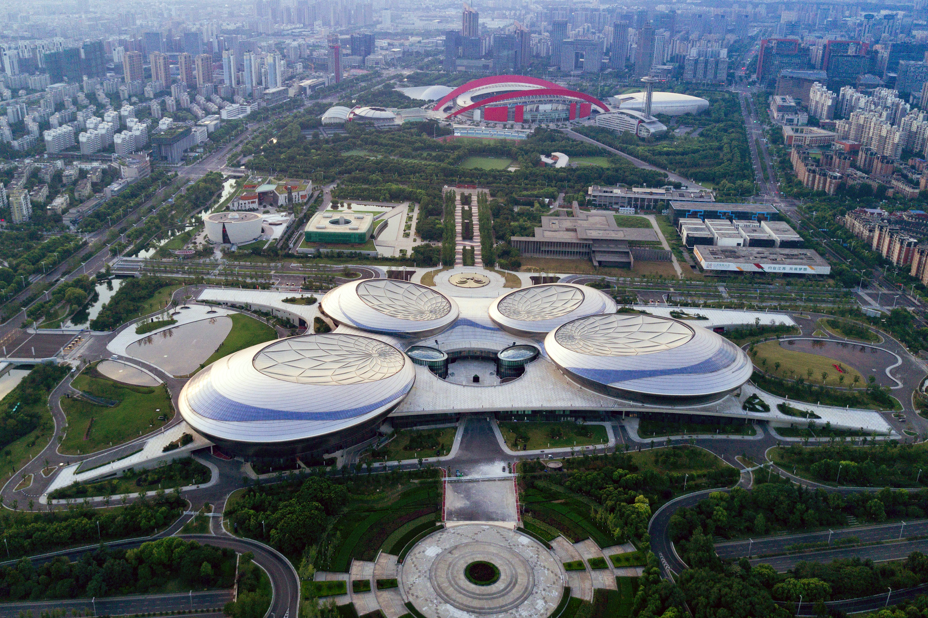 Slide 44 of 57: CAPTION: NANJING, CHINA - JULY 20: Aerial view of Jiangsu Grand Theatre on July 20, 2017 in Nanjing, Jiangsu Province of China. As the largest performing arts centre project in China to open in the past 10 years, the theatre includes six performing halls: 2,300-seat opera house, 1,500-seat concert hall, 1,000-seat drama theatre, 3,000-seat conference hall and two small conference halls. A press conference was held on Thursday to announce that Nanjing Grand Theatre is to open on August 15 this year. (Photo by Yang Bo/CHINA NEWS SERVICE/VCG via Getty Images)