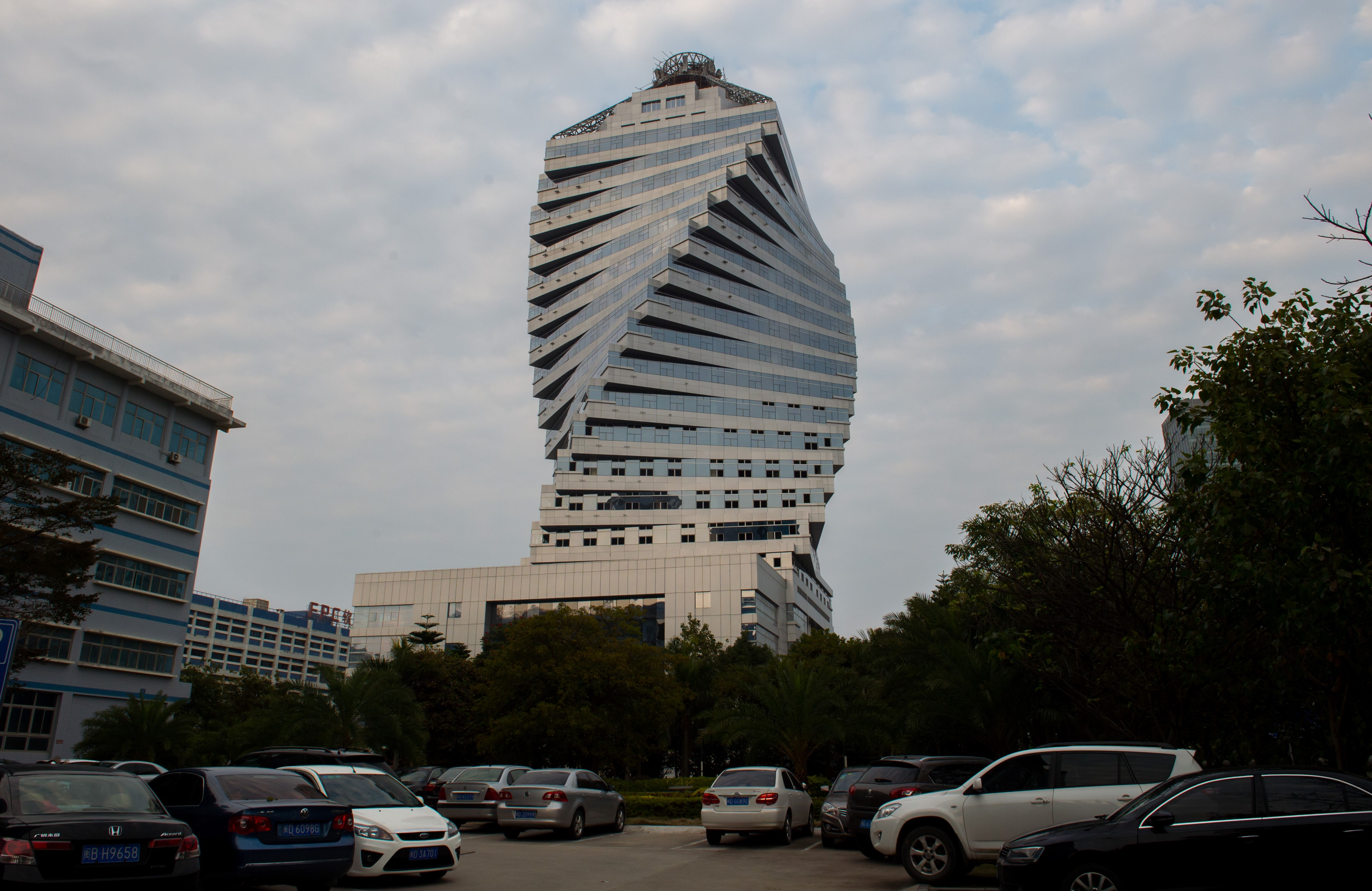 Slide 51 of 57: XIAMEN,CHINA - FEBRUARY 15 : Twisted shaped building of The Phase Two R&D center of Suiwa High Technology Electronic Industries Co, Ltd is seen in Xiamen, China's southeast Fujian province on February 15, 2016. The building shaped as DNA spiral. It is reported that the building high 99.7 meters with the 22-story high-rise, design unique, distorted straight, is currently in the under construction state. Citizens called it 'twisted building'. (Photo by Zhong Zhenbin/Anadolu Agency/Getty Images)