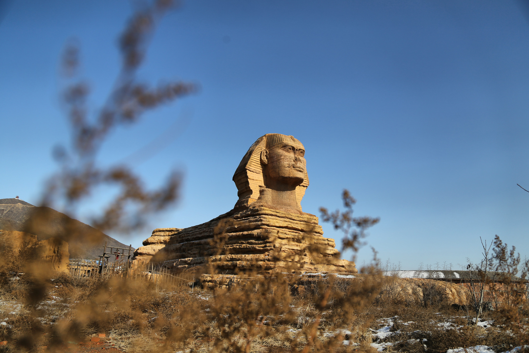 Slide 40 of 57: SHIJIAZHUANG, CHINA - DECEMBER 03: (CHINA OUT) A replica of Sphinx is seen in a new studio park on December 3, 2015 in Shijiazhuang, Hebei Province of China. A complex building mixed three-story China's Hall of Prayer for Good Harvest as its north part and a four-story western architecture as its south part was built in a new studio park which also contained replicas of Egyptian Sphinx, French Louvre Pyramid and some Chinese ancient buildings in Shijiazhuang. (Photo by VCG/VCG via Getty Images)