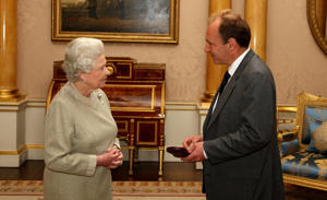 Her Majesty Queen Elizabeth II invests Sir Timothy Berners-Lee with the insignia of a Member of the Order of Merit