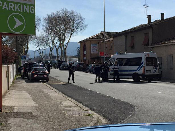 Police surround the Super U supermarket in Trebes in the south of France