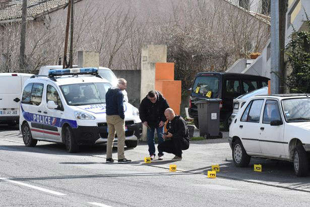 Police investigate the scene where officers were shot at in Carcassonne