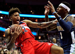 Mar 23, 2018; Washington, DC, USA; Washington Wizards forward Kelly Oubre Jr. (12) is fouled by Denver Nuggets guard Torrey Craig (3) during the first half at Capital One Arena. Mandatory Credit: Brad Mills-USA TODAY Sports - 10728862
