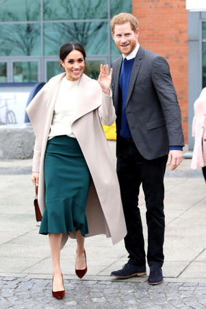 The fiancee of Britain's Prince Harry, Meghan Markle, reacts after a visit to a science park called Catalyst Inc., in Belfast, Northern Ireland March 23, 2018.  Chris Jackson/Pool via Reuters