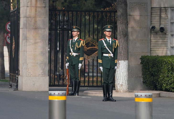 Paramilitary police officers stand guard outside the Diaoyutai State Guesthouse, where foreign dignitaries usually stay, in Beijing, China March 27, 2018. REUTERS/Jason Lee