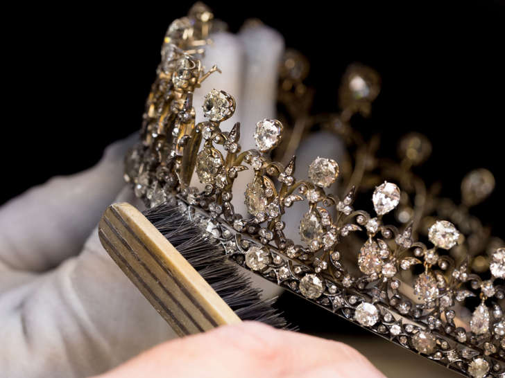 Undated handout photo issued by Historic Royal Palaces of a conservator polishing the Fife Tiara in preparation for its display at Kensington Palace for the Victoria Revealed exhibition.