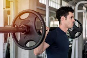 Weightlifter lifting barbells