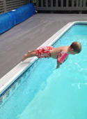 Two-year-old boy performs unique dive into swimming pool