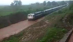 Train gets stuck on waterlogged rail track