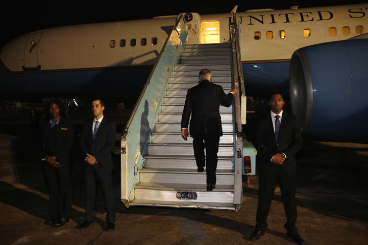 U.S. Secretary of State Rex Tillerson boards his plane to depart at the end of a five-country swing through Africa from Abuja, Nigeria, Monday, March 12, 2018.
