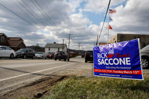 A sign for Republican congressional candidate Rick Saccone is seen in Elizabeth Township, Pennsylvania, U.S. March 12, 2018.